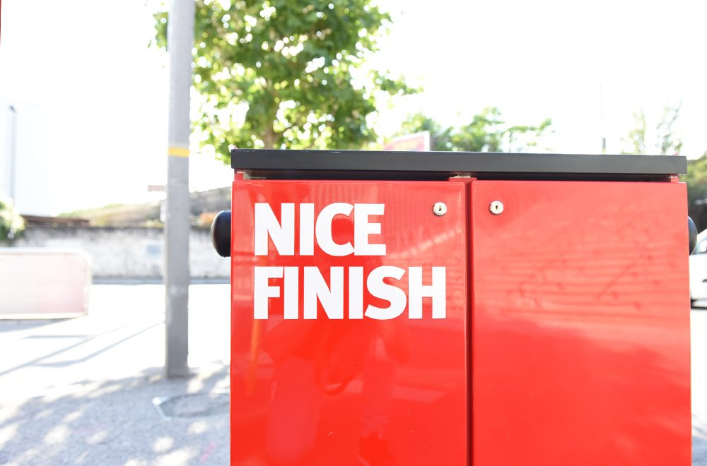 A red electrical box with text on outside Arsenal Football Club