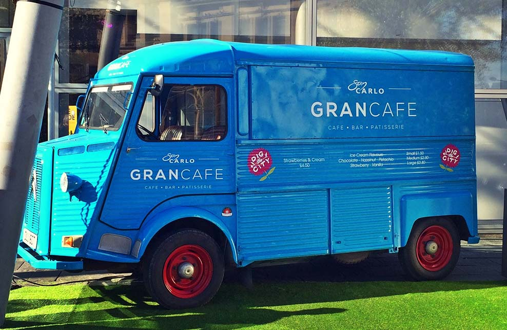 A blue HY catering van conversion for Gran Cafe