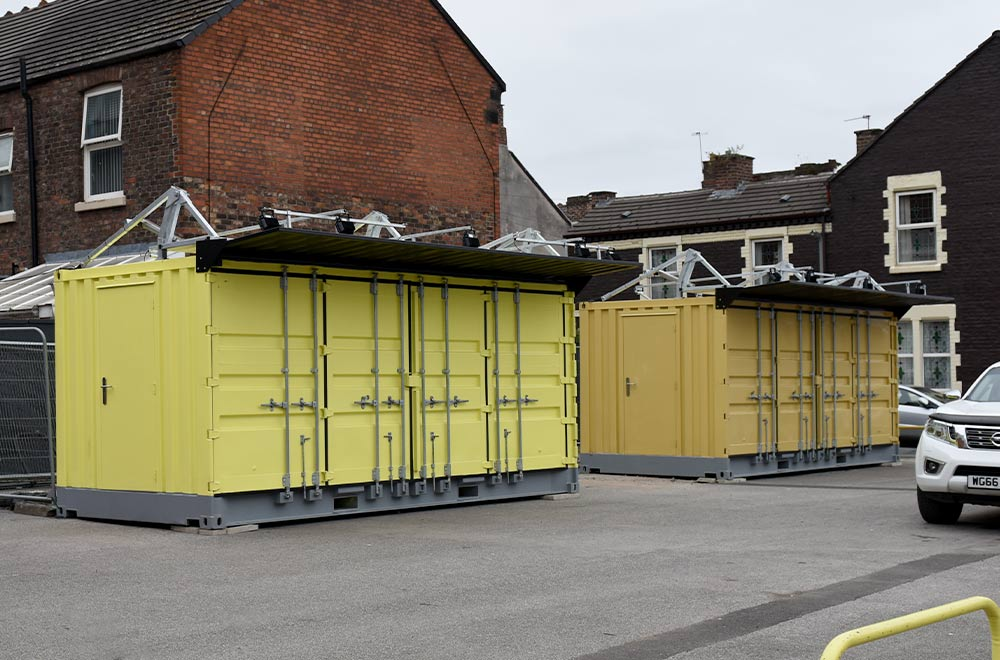 Shipping containers at Anfield stadium before being converted into catering kiosks