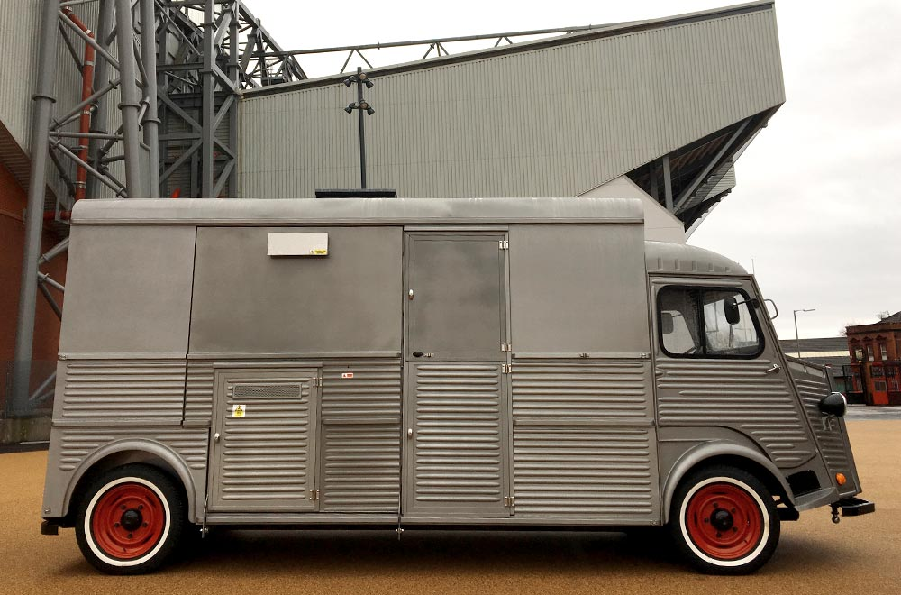side view of silver HY van conversion outside Anfield stadium