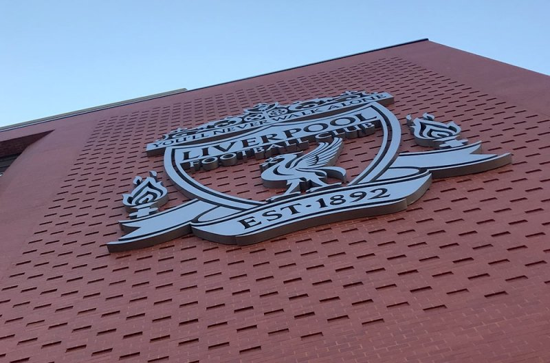 Liverpool football club badge on the side of Anfield stadium