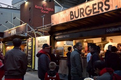 Catering kiosk serving customers outside Anfield Stadium