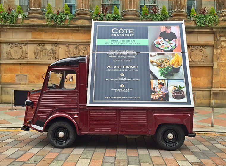A custom made Citroen HY van with advertising board on the back