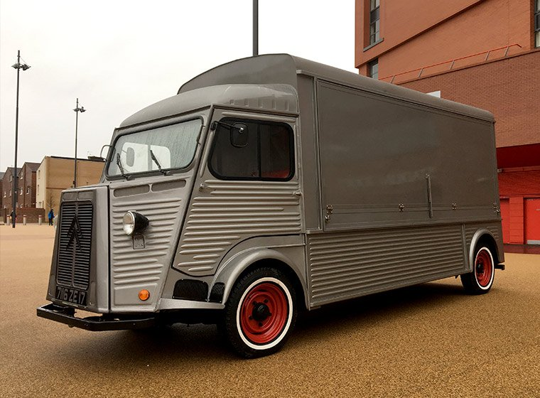 A silver Citroen HY van conversion outside Anfield Stadium