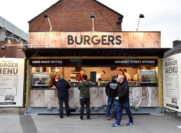 A catering liosk serving customers outside Anfield Stadium
