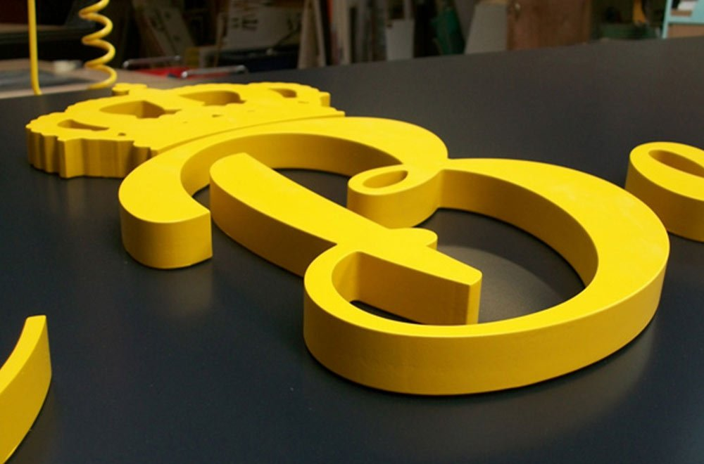 yellow 3d sign