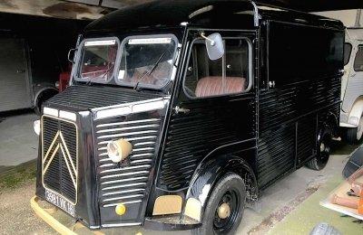 A black Citroen HY van conversion in a garage