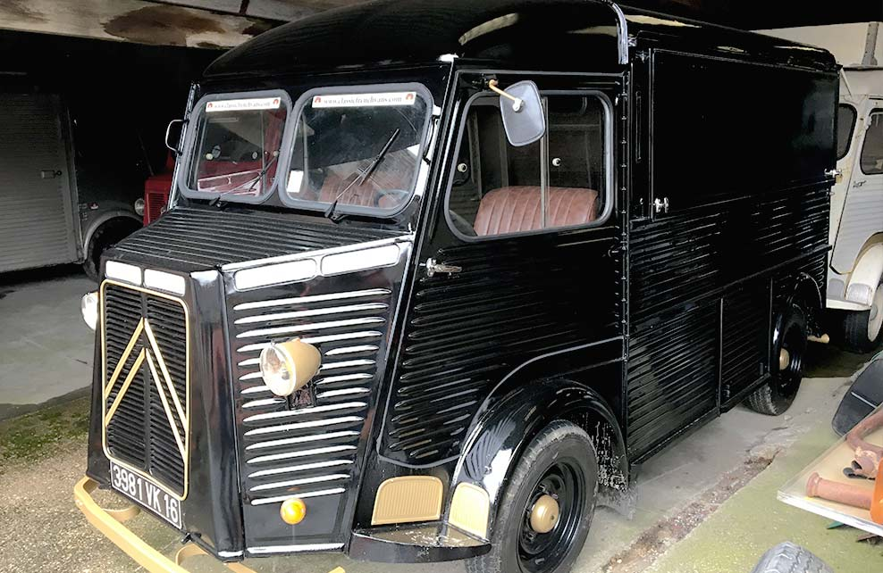 A black Citroen HY van conversion in a garage