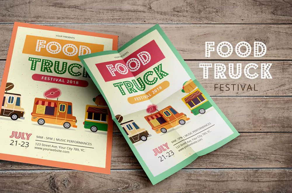 two marketing flyers for the food truck festival on a wooden background
