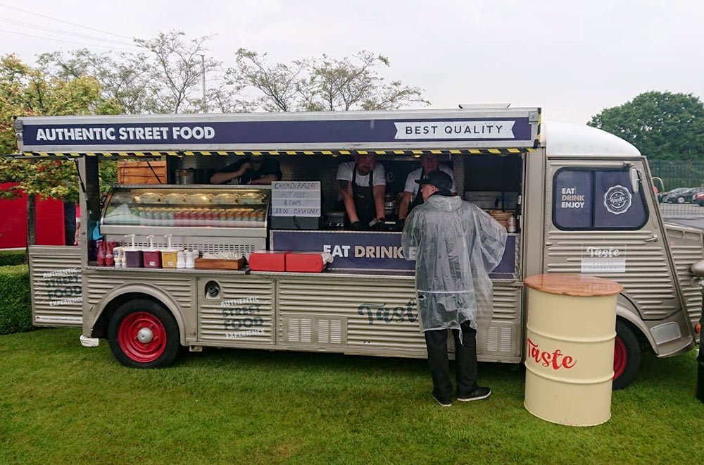 taste hy van conversion with side open serving customers outside Aintree