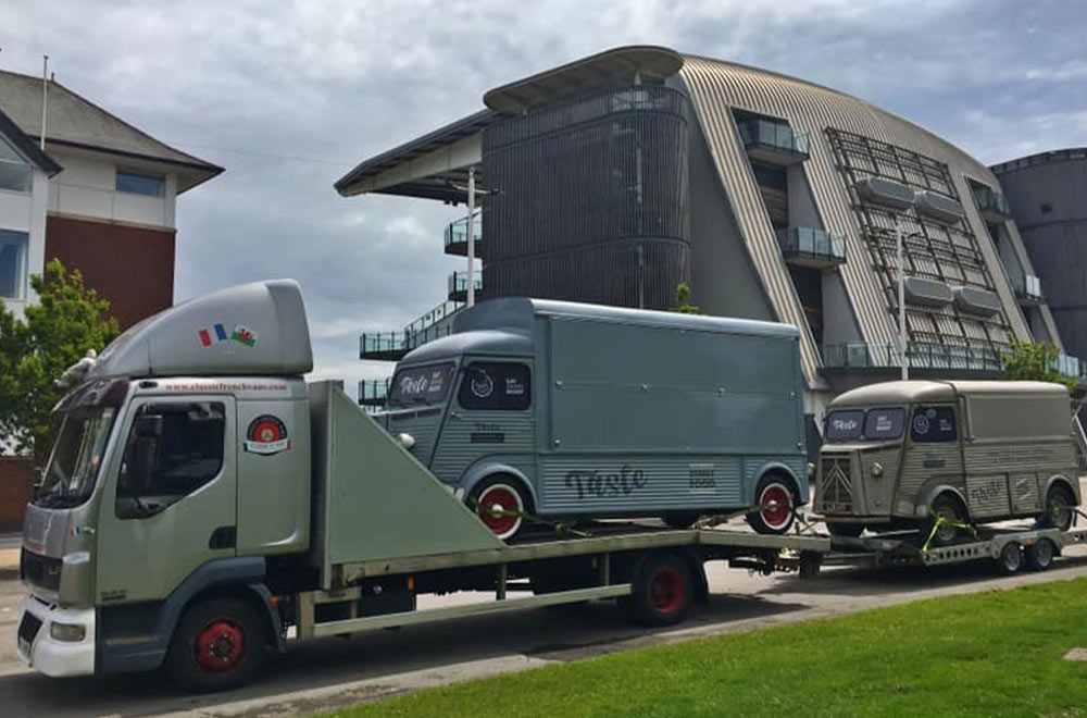 two taste hy van conversions on the transport lorry outside Aintree