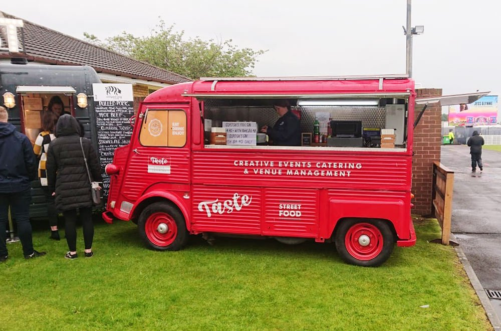 red taste hy van conversion with side open outside Aintree