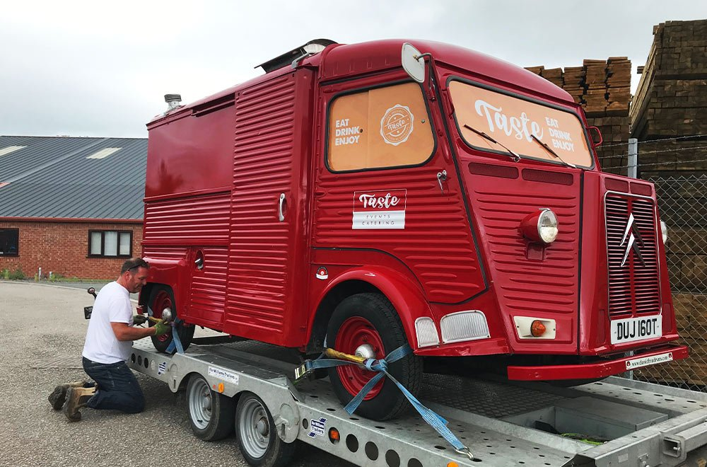 red taste hy van conversion loading onto trailer