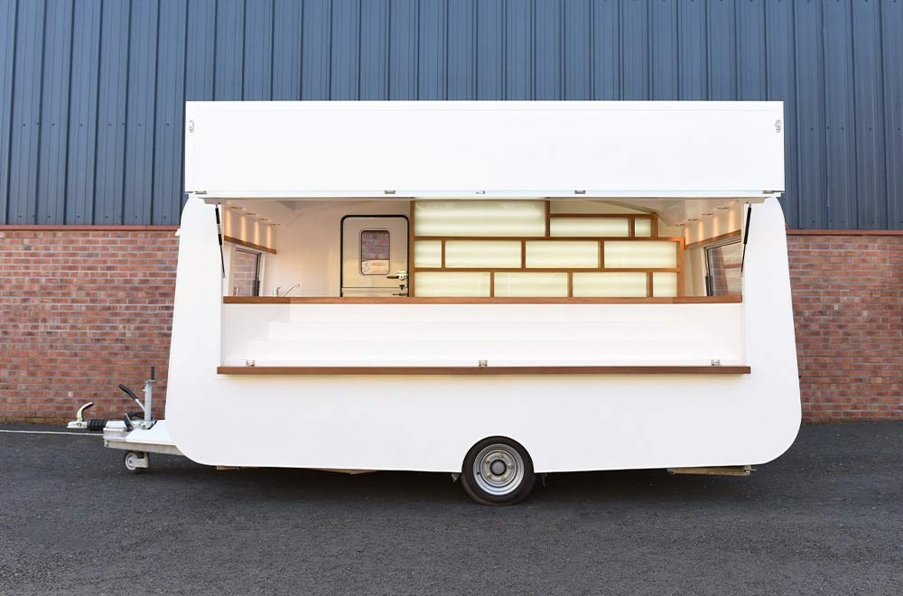a plain caravan with the side open before branding for Ted Baker