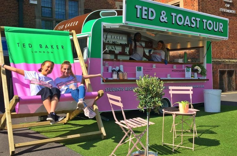 ted baker caravan conversion with side open and staff posing